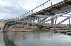 Dual Walkway Bridges - The Passerelle De La Paix Bridge in France Has a Slender, Asymmetric Design