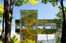 This Modern Tower House Refelcts the Forest and Surrounding Area