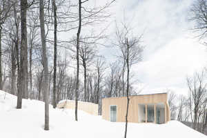 La SHED Architecture's Blue Hills Home is a Cozy Cabin in Quebec