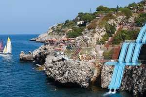 Citta Del Mare Hotel's Water Slide Flows Down a Cliff into the Ocean