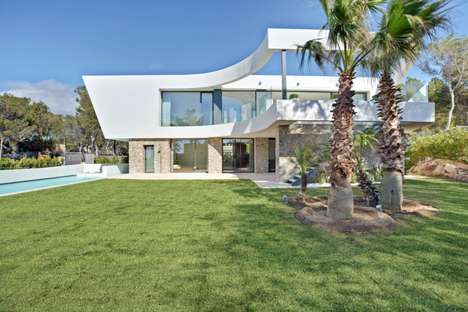 Curving Seaside Havens - This Stunning Mediterranean Villa Mixes Contemporary with Mid-Century