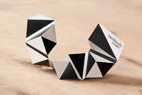 Decreasing Origami Cartons - The U Shape Travel Set Conveniently Downsizes During Your Trip