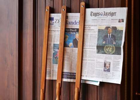 High-Tech Newspaper Holders - Jung von Matt Used a Digital Gimmick to Launch Neuer Zürcher Zeitung