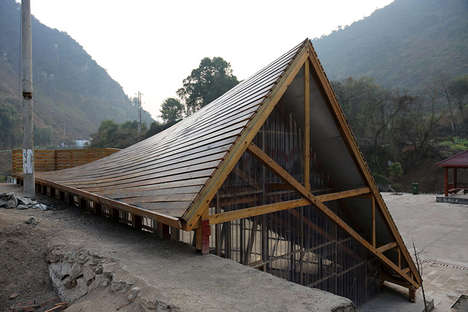 Sloping-Roofed Libraries - The Pinch: Library and Community Center Helps Children in China