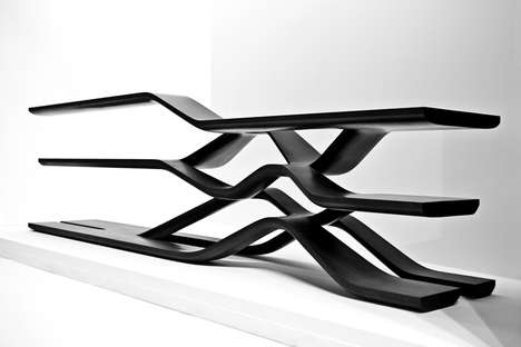 Flowing Unibody Shelves - Zaha Hadid Uses Black Marble to Create This Beautifully Unique Design