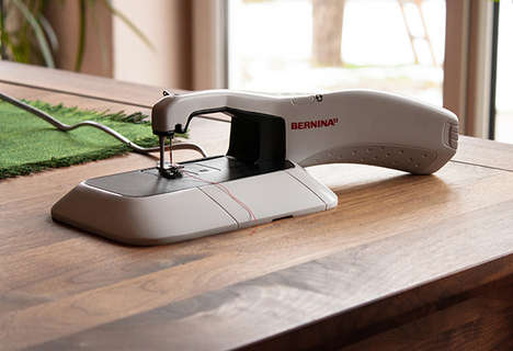 Hybrid Sewing Machines - The Bernina B100 by Laura Lang is a Portable Handheld Sewing Machine