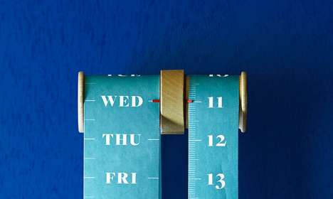Suspended Spool Schedules - The Roll Calendar Displays the Date On a Bound Paper Band