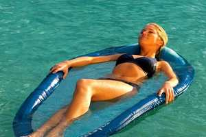 The Floating Water Hammock Will Make Relaxing in Your Pool Even More Fun