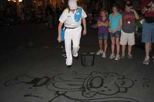 Disney Janitors Draw Cartoon Characters with Water on Concrete