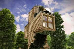 The Skit is a Wooden Home by Dachi Papuashvili that is Shaped like a Cross