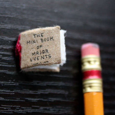 Diminutive Historical Texts - The Mini Book of Major Events Illustrates Pivotal Moments on Earth
