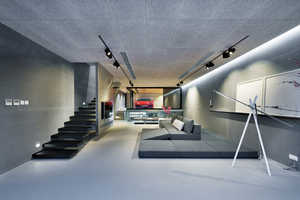 This Home by Millimeter Interior Design Features a Parked Ferrari Inside
