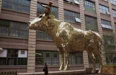 Suspended Golden Calf Sculptures - The Giant Pinata by Sebastian Errazuriz Challenges Capitalism