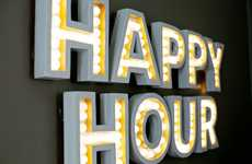 Illuminated DIY Wall Displays - The A Beautiful Mess Happy Hour Marquee Lights Up Homes