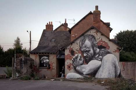 Giant-Adorned Abodes - MTO Created a Series of Giant Murals That Depict Giants on the Sides of Homes