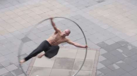 Giant Hoop Acrobatics - Isaac Hou, The Ring Man, Spins Mesmerizingly and Gymnastically