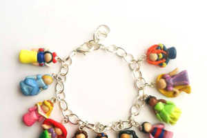 These Charm Bracelets Come with Tiny Polymer Clay Princesses