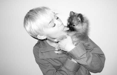 Puppy-Smooching Pictures - Miley Cyrus