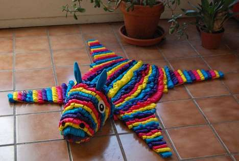 Vibrant Taxidermy Carpets - The Felt Pinata Skin Rug by SomeRabbits is a Fun Party Decoration
