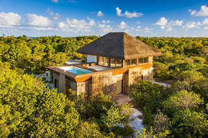 This Beachside Tropical Resort is Stunning and Authentic
