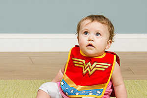 These Heroic Bibs and Booties Turn Any Baby into a Caped Crusador