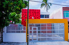 Vibrant-Hued Homes - The Coral House Stands Out in the Neighborhood