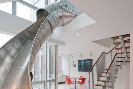 Playful Playground Interiors - This Spiral Metal Slide Design Connects Two Penthouses