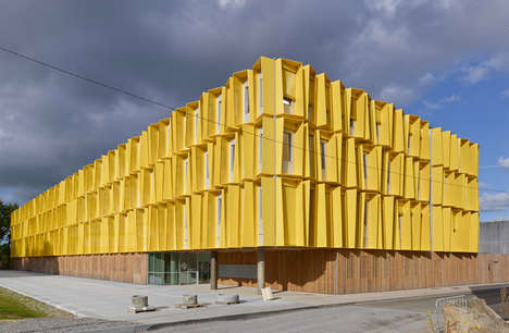 Irregular Shading Facades - Tetrarc Turns an Office Building into a Yellow Geometric Shape