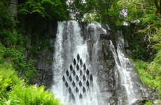 Cascading Waterfall Installations - Les Cascadeurs is Located in the Heart of a Waterfall