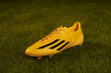 Yellow-Drenched Soccer Boots