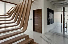 Harmonious Sculptural Staircases - This Sculptural Wooden Staircase Pulls a Space Together