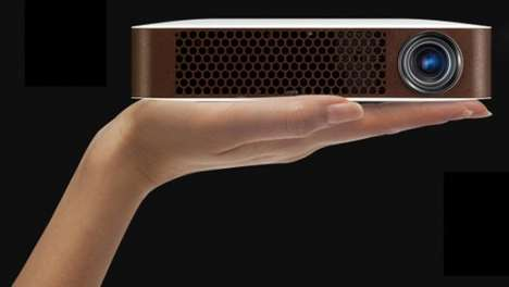 Compact Bluetooth Projectors - The Bluetooth MiniBeam Projector Fits On the Palm Of Your Hand