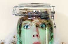 Floating Face Jars - This DIY Halloween Decoration is a Jar of Pickled Heads