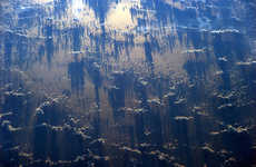 Stellar Spatial Series - Alexander Gerst Photographs Shadows Clouds Cast on Earth From Space