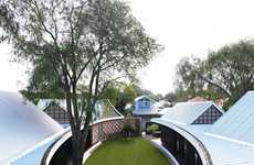 Elliptical Courtyard Abodes - This Home's Central Component is an Oval Courtyard