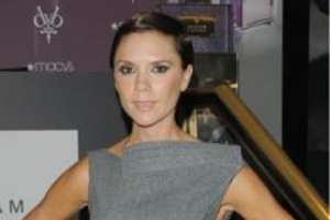 Victoria Beckham Matches Whip to Wardrobe