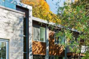 BOOM TOWN Designed a Cottage with a Natural Emphasis