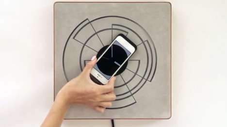 Spiral Smartphone Smartchargers - The Spira Frame Turns Your Phone Into a Work of Art