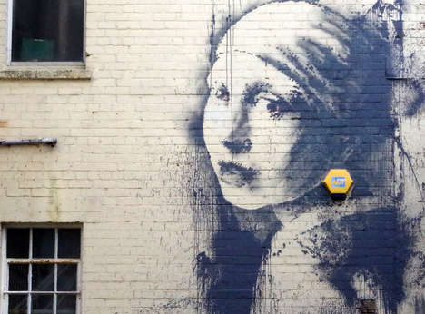 Classical Painting Street Art - Girl with a Pierced Eardrum by Banksy Incorporates a Security Alarm