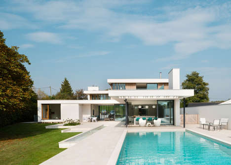 Landscape-Oriented Mansions - This Three-Storey Concrete Home Features a Moat-Like Entrance