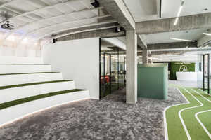 Onefootball's Athletic HQ Design Features a Fake Grass Running Track
