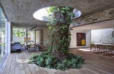 Forest-Conscious Abodes - The Brazilian Tree House is Built Around a Thousand-Year-Old Tree