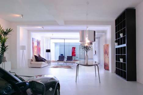 Airy Garage Lofts - This Loft Space Accommodates a Sports Car in the Living Room