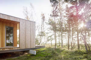This Wooden Summer House Sits Perched in the Swedish Woodland