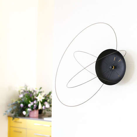 Planetary Wall Clocks - The Orbits Clock by Studio Ve Features Rotating Loops to Tell Time