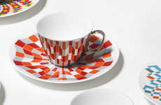 Chameleon Cup Designs - The D-BROS Teacup and Saucer Set Mirror Each Other to Match Prints Perfectly