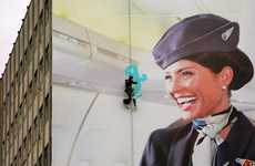 Abseiling Pilots - Air New Zealand Staff Paints Billboard