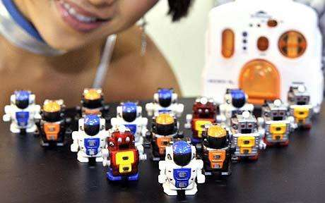 Soccer-Playing Mini Robots