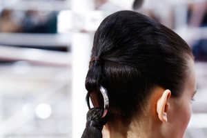 The Christian Dior Couture Hair Style Features Divided 'Couture' Ponytails