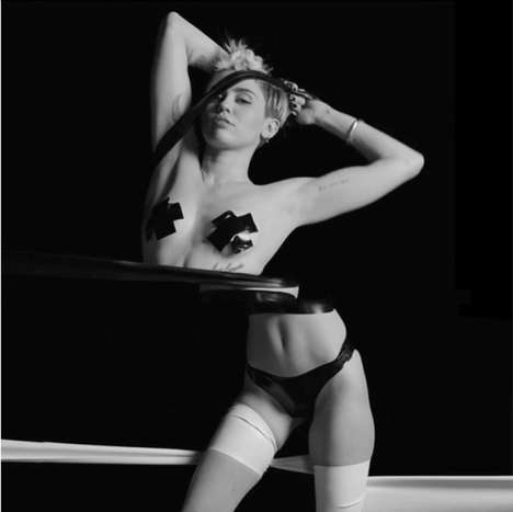Racy Art Pop Motifs - 'Tongue Tied' by Miley Cyrus Features an Artistic Perspective on BDSM